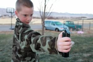 Boy with Pepper Spray Copyright_YourFamilyArkLLC_online