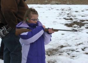Girl Shooting Rifle Copyright_YourFamilyArkLLC