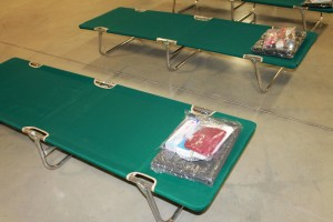 Shelter cot with blanket and hygiene kit - Copyright Your Family Ark LLC