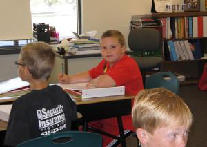 Sam in classroom - Copyright Your Family Ark LLC