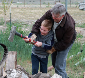Father and son splitting firewood