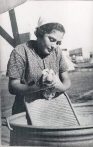 Woman washing clothes on board